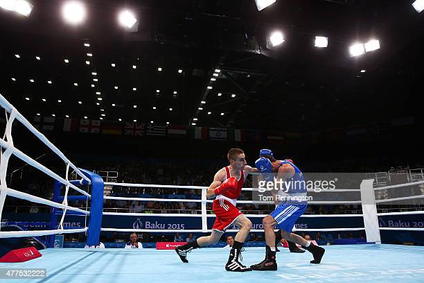 Matteo Komadina of Croatia and Igor Lazarev of Israel compete in the Men's Boxing Light 60kg round of 32 bout during day six of the Baku 2015...