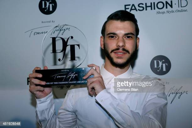Matteo Lamandini poses with the DfT Award by Peek Cloppenburg Duesseldorf and Fashion ID as part of MercedesBenz Fashion Week Spring/Summer 2015 at...