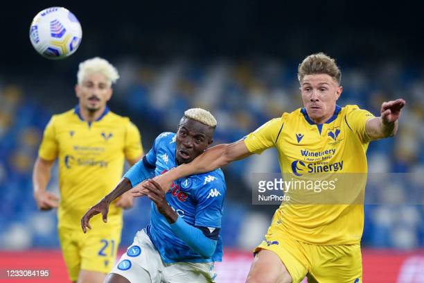 Matteo Lovato of Hellas Verona and Victor Osimhen of SSC Napoli compete for the ball during the Serie A match between SSC Napoli and Hellas Verona at...