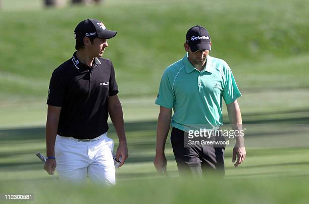 Matteo Manassero of Italy and Sergio Garcia of Spain walk down the 9th hole during the first round of the Transitions Championship at Innisbrook...