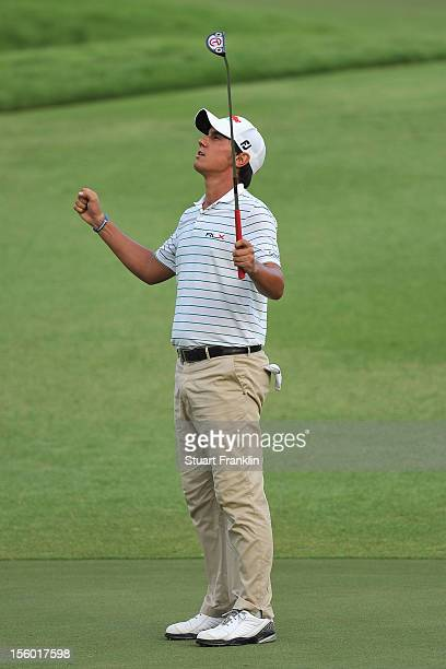 Matteo Manassero of Italy celebrates holeing his eagle putt during the third playoff hole after the final round of the Barclays Singapore Open at the...