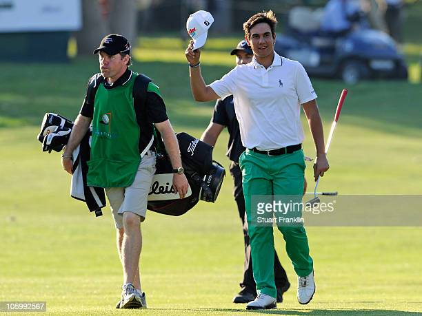 Matteo Manassero of Italy celebrates with his caddie on the 18th hole during the final round of the Castello Masters Costa Azahar at the Club de...