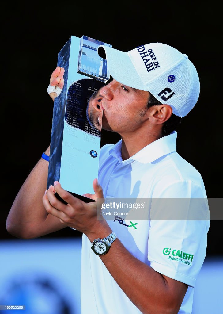 Matteo Manassero of Italy celebrates with the trophy on the eighteenth green after winning the fourth play-off hole during the final round of the BMW PGA Championship on the West Course at Wentworth on May 26, 2013 in Virginia Water, England.