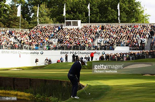Matteo Manassero of Italy chips into the 18th green during the second round of the BMW PGA Championship at the Wentworth Club on May 27 2011 in...