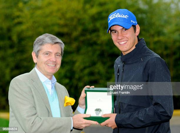 Matteo Manassero of Italy is presented with a Rolex watch by Gianpaolo Marini of Rolex after the first round of the BMW Italian Open at Royal Park I...