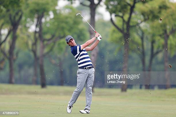 Matteo Manassero of Italy plays a shot during the day two of the Volvo China Open at Tomson Shanghai Pudong Golf Club on April 24, 2015 in Shanghai,...