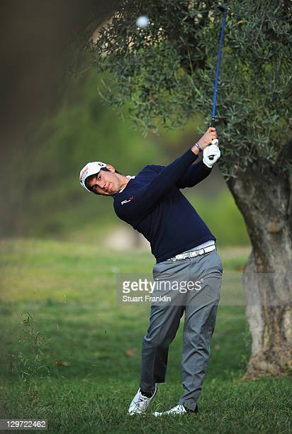 Matteo Manassero of Italy plays a shot during the first round of the Castello Masters Costa Azahar at the Club de Campo del Mediterraneo on October...