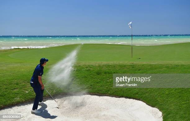 Matteo Manassero of Italy plays from a bunker on the 7th hole during day three of The Rocco Forte Open at Verdura Golf and Spa Resort on May 20 2017...