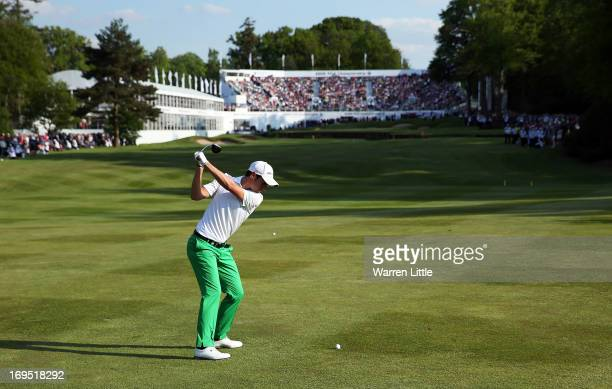 Matteo Manassero of Italy plays his approach on the eighteenth hole in the third playoff hole during the final round of the BMW PGA Championship on...