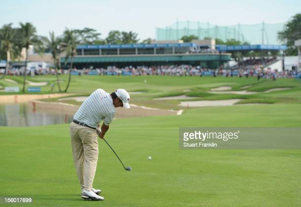Matteo Manassero of Italy plays his approach shot on the 18th hole during the playoff hole after the final round of the Barclays Singapore Open at...