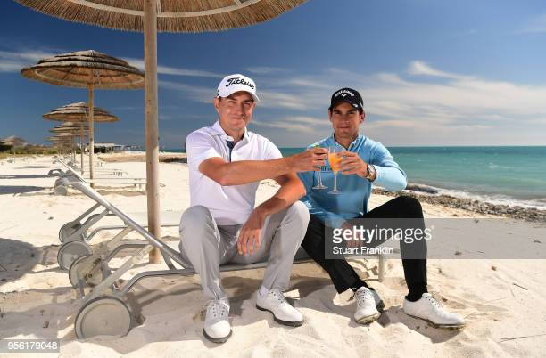 Matteo Manassero of Italy shares a drink with Jason Scrivener of Australia prior to the start of The Rocco Forte Open at the Verdura golf resort on...