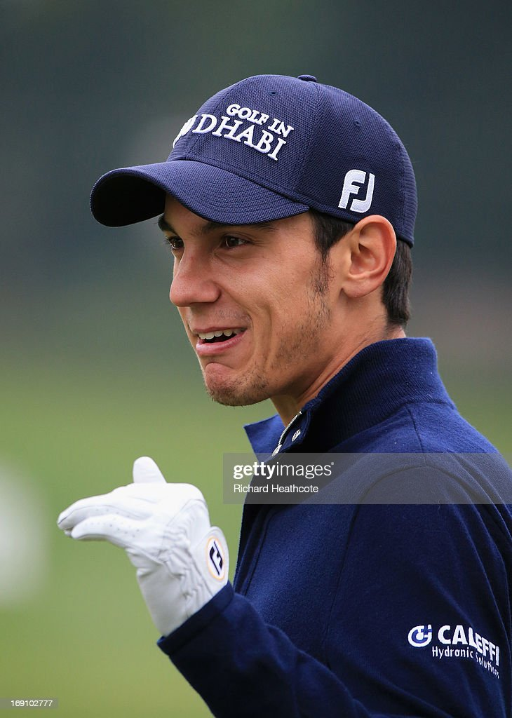 Matteo Manassero of Italy smiles while on the driving range during a practise day for the BMW PGA Championships at Wentworth on May 20, 2013 in Virginia Water, England.