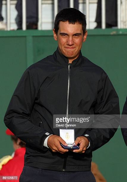 Matteo Manassero of Italy winner of the silver medal for the highest placed amateur during the final round of the 138th Open Championship on the...
