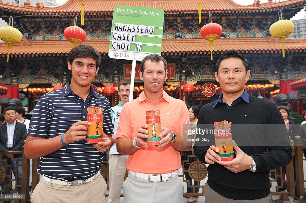 Matteo Manassero, Paul Casey and Wilson Choi pose at The Wong Tai Sin Temple ahead of the Hong Kong Open on November 12, 2012 in Hong Kong.