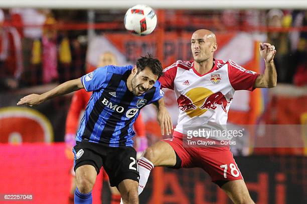 Matteo Mancosu of Montreal Impact is challenged by Aurelien Collin of New York Red Bulls during the New York Red Bulls Vs Montreal Impact MLS playoff...