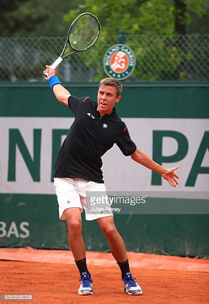 Matteo Martineau of France hits a backhand during the Boys Singles first round match against Mate Valkusz of Hungary on day eight of the 2016 French...