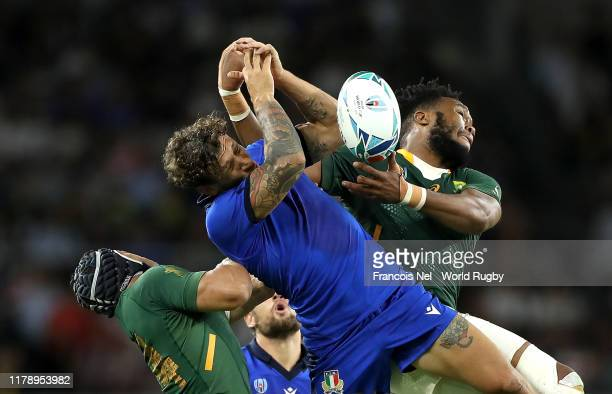 Matteo Minozzi of Italy challenges for the ball in the air against Cheslin Kolbe and Lukhanyo Am of South Africa during the Rugby World Cup 2019...