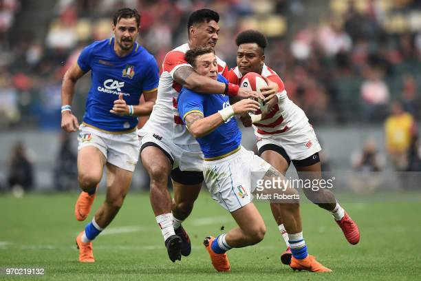Matteo Minozzi of Italy is tackled during the Rugby international match between Japan and Italy at Oita Bank Dome on June 9 2018 in Oita Japan