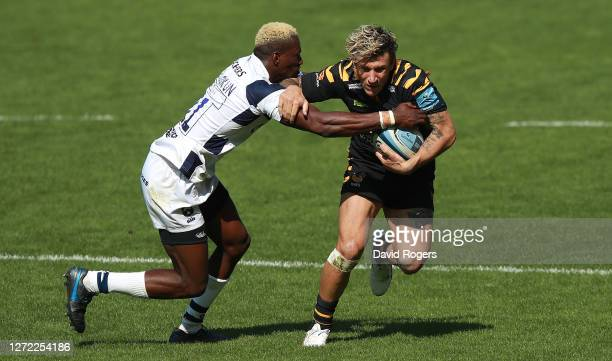 Matteo Minozzi of Wasps is tackled by Niyi Adeolokun during the Gallagher Premiership Rugby match between Wasps and Bristol Bears at the Ricoh Arena...