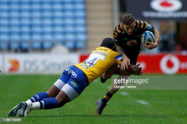 Matteo Minozzi of Wasps is tackled by Semesa Rokoduguni of Bath during the Gallagher Premiership Rugby match between Wasps and Bath Rugby at the...