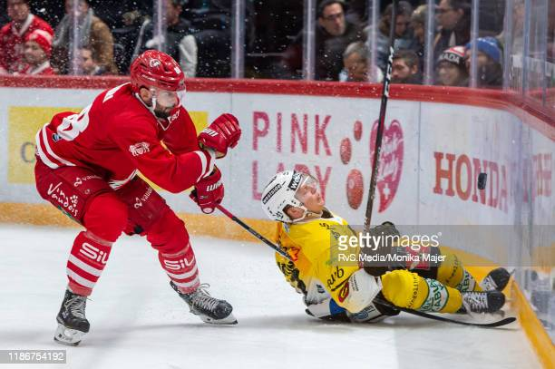 Matteo Nodari of Lausanne HC clashes with Gregory Sciaroni of SC Bern during the Swiss National League game between Lausanne HC and SC Bern at...