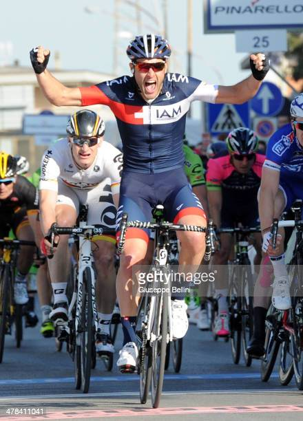 Matteo Pelucchi of IAM Cycling crosses the finish line and wins the stage two of the 2014 Tirreno Adriatico, a 166 km stage from San Vincenzo to...