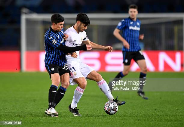 Matteo Pessina of Atalanta battles for possession with Marco Asensio of Real Madrid during the UEFA Champions League Round of 16 match between...