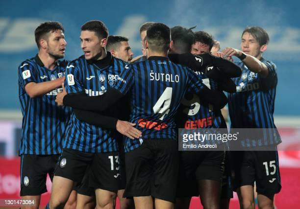 Matteo Pessina of Atalanta celebrates with Mattia Caldara and team mates after scoring their side's third goal during the Coppa Italia match between...