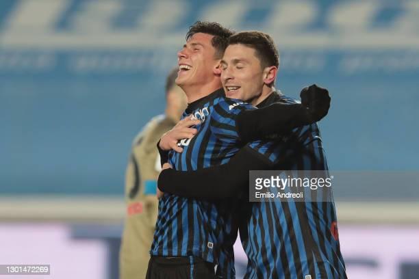 Matteo Pessina of Atalanta celebrates with team mate Mattia Caldara after scoring their side's third goal during the Coppa Italia match between...