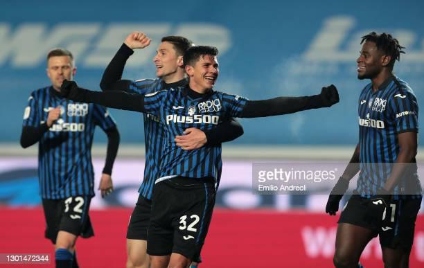 Matteo Pessina of Atalanta celebrates with team mates Mattia Caldara and Duvan Zapata after scoring their side's third goal during the Coppa Italia...