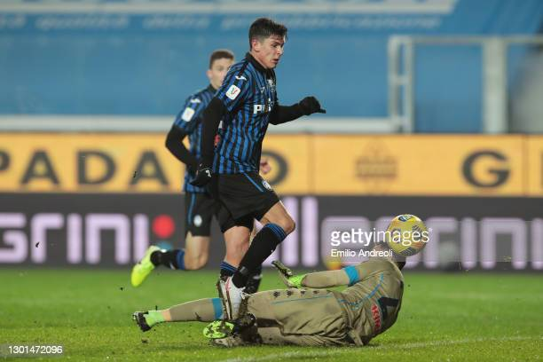 Matteo Pessina of Atalanta scores their side's third goal past David Ospina of Napoli during the Coppa Italia match between Atalanta BC and SSC...