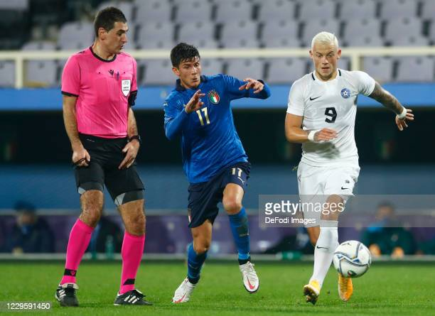 Matteo Pessina of Italy and Erik Sorga of Estonia battle for the ball during the International Friendly match between Italy and Estonia at Stadio...