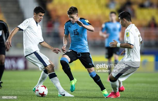 Matteo Pessina of Italy and Riccardo Orsolini of Italy challenges Facundo Waller of Uruguay during the FIFA U20 World Cup Korea Republic 2017 group D...