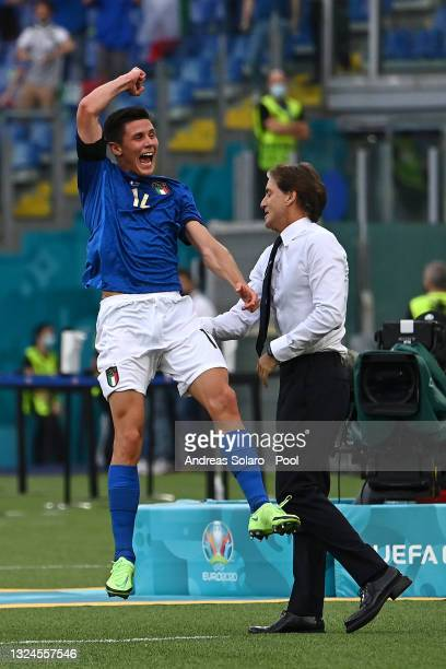 Matteo Pessina of Italy celebrates with Roberto Mancini, Head Coach of Italy after scoring their side's first goal during the UEFA Euro 2020...