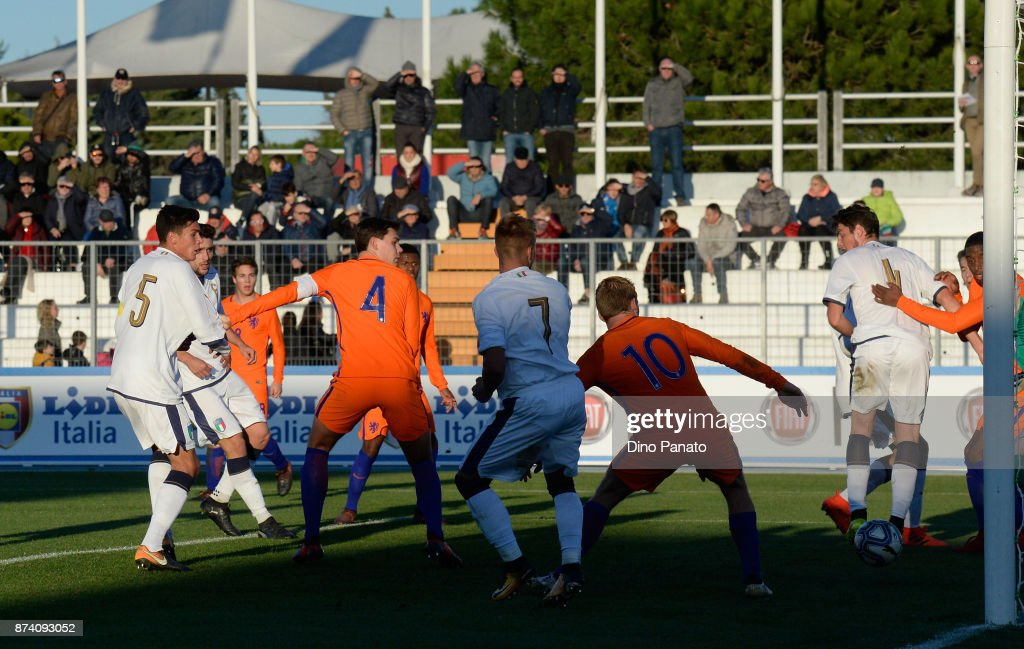 Matteo Pessina (L) of Italy U20 scores his opening goal during the 8 Nations Tournament match between Italy U20 and Netherlands U20 at Stadio G. Teghil on November 14, 2017 in Lignano Sabbiadoro, Italy.