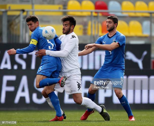 Matteo Pessina with his teammate Mauro Coppolaro of Italy U20 compete for the ball with Michele Volpe of Team Lega B during the friendly match...