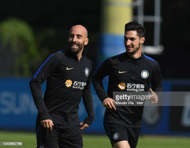 Matteo Politano and Borja Valero of FC Internazionale chat during a training session at the club's training ground Suning Training Center in memory...