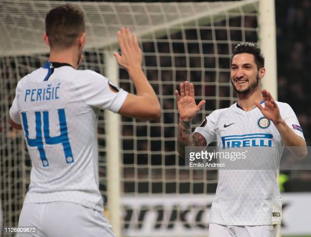 Matteo Politano of FC Internazionale celebrates his goal with his teammate Ivan Perisic during the UEFA Europa League Round of 32 Second Leg match...