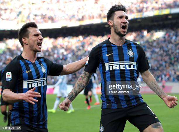 Matteo Politano of FC Internazionale celebrates with his teammate Cedric Soares after scoring the opening goal during the Serie A match between FC...