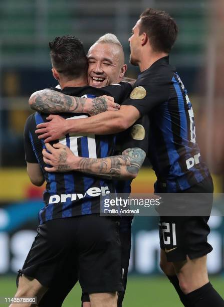 Matteo Politano of FC Internazionale celebrates with his teammate Radja Nainggolan and Cedric Soares after scoring the opening goal during the Serie...
