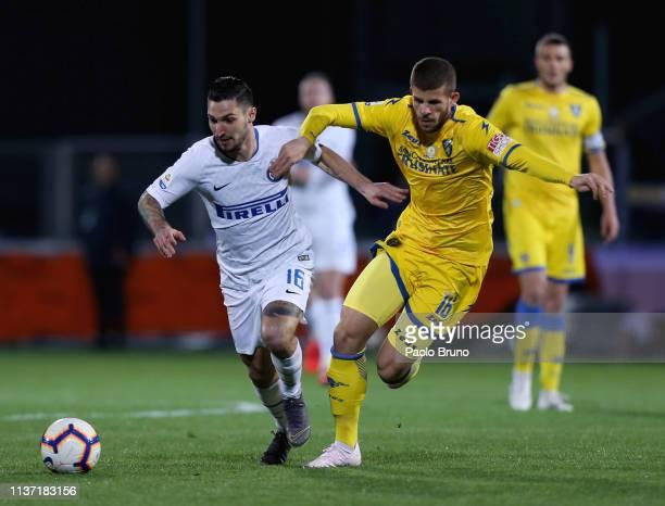 Matteo Politano of FC Internazionale competes for the ball with Luca Valzania of Frosinone Calcio during the Serie A match between Frosinone Calcio...