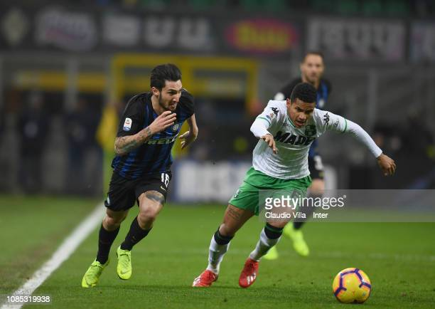 Matteo Politano of FC Internazionale competes for the ball with Rogerio of US Sassuolo during the Serie A match between FC Internazionale and US...
