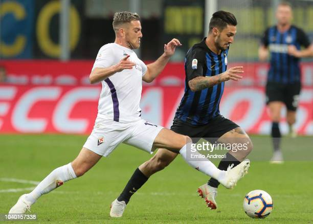 Matteo Politano of FC Internazionale is challenged by Jordan Veretout of ACF Fiorentina during the Serie A match between FC Internazionale and ACF...