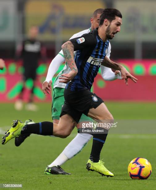 Matteo Politano of FC Internazionale is challenged by Kevin Prince Boateng of US Sassuolo during the Serie A match between FC Internazionale and US...