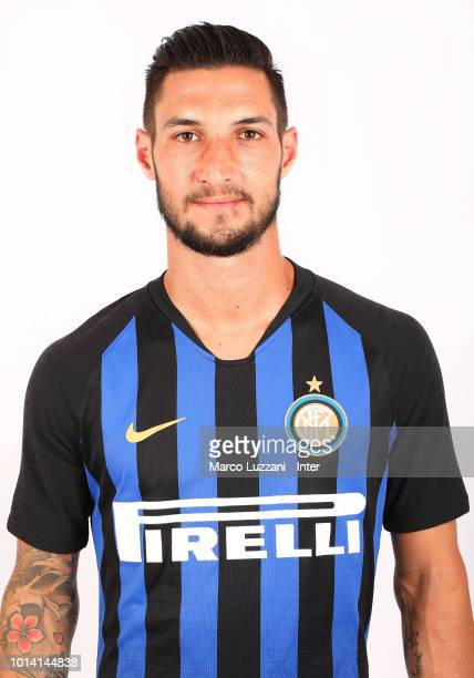 Matteo Politano of FC Internazionale poses with the club shirt at the club's training ground Suning Training Center in memory of Angelo Moratti on...