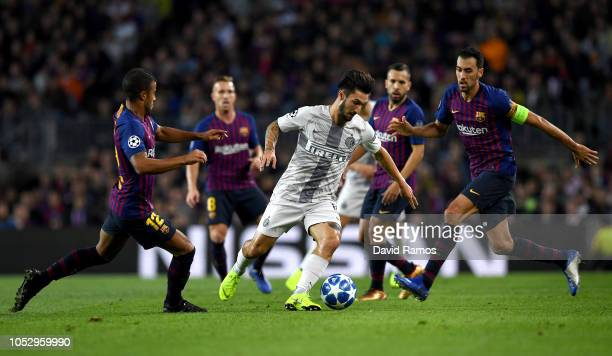 Matteo Politano of Inter Milan in action while under pressure from Rafinha Arthur Jordi Alba and Sergio Busquets of Barcelona during the Group B...