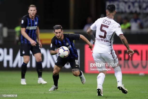 Matteo Politano of Internazionale Armando Izzo of Torino during the Italian Serie A match between Internazionale v Torino at the San Siro on August...