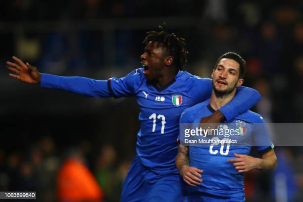 Matteo Politano of Italy celebrates with team mate Moise Kean after scoring his team's first goal during the International Friendly match between...