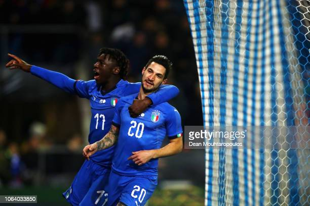 Matteo Politano of Italy celebrates with team mate Moise Kean after scoring his team's first goal in the final minute to win the match during the...