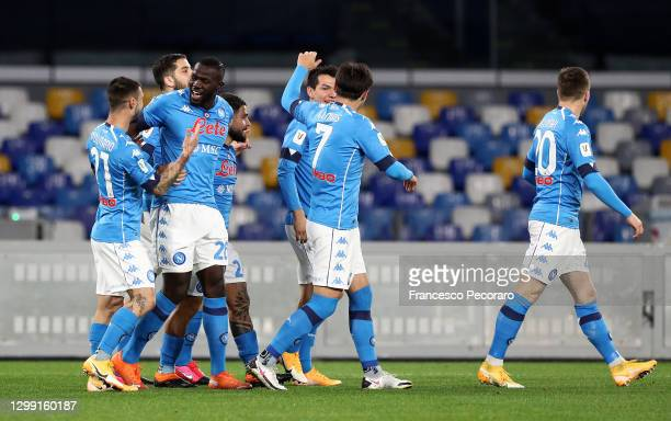 Matteo Politano of S.S.C. Napoli , and Lorenzo Insigne of S.S.C. Napoli celebrate with Kalidou Koulibaly of S.S.C. Napoli after he scores his sides...
